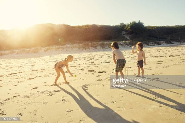 where there's sun, there's fun - beach cricket stock pictures, royalty-free photos & images