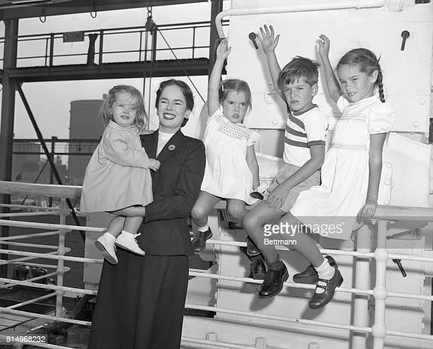 Where's Charlie New York NY Mrs Charlie Chaplin the former Oona O'Neill is shown with her four children as the Chaplin family sailed for Europe today...