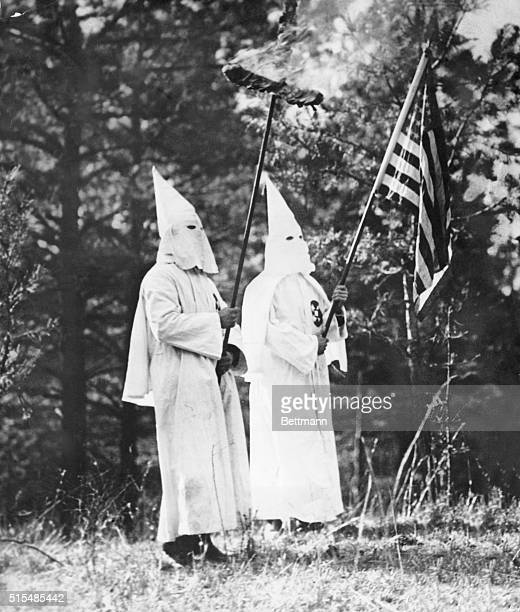 Wherever the Knights of the Ku Klux Klan is found there is always found the inseparable symbols of the organizations the American flag and the fiery...