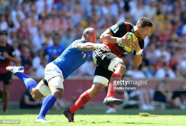Whetu Douglas of the Crusaders attempts to break away from the defence during the Rugby Global Tens match between the Crusaders and Samoa at Suncorp...