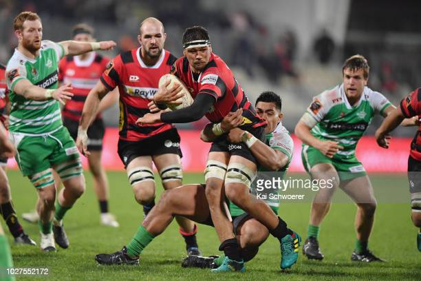 Whetukamokamo Douglas of Canterbury is tackled by Michael Alaalatoa of Manawatu during the round four Mitre 10 Cup match between Canterbury and...