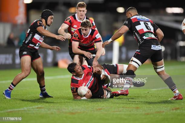Whetukamokamo Douglas of Canterbury is tackled during the round 8 Mitre 10 Cup match between Canterbury and Counties Manukau at Orangetheory Stadium...