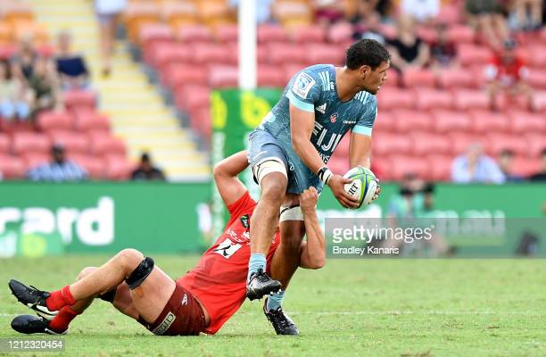 Whetukamokamo Douglas of the Crusaders takes on the defence during the round seven Super Rugby match between the Sunwolves and the Crusaders at...