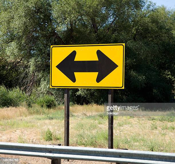which way to turn - double arrow stock pictures, royalty-free photos & images
