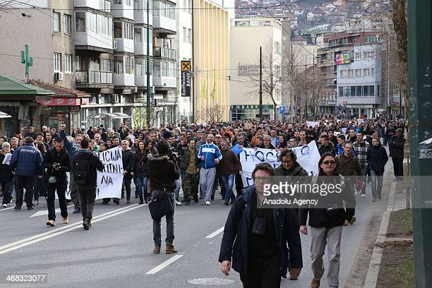 While a group of Bosnians block the main road in front of the Presidency building security forces take security precautions in Sarajevo Bosnia and...