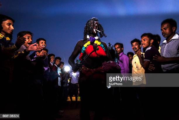 While a performer is doing various acts on the road the spectators are clapping to give him encouragement in Burdwan India on 13 April 2017...