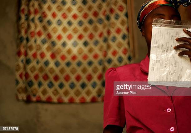 While covering her face with a health report a woman describes her rape to a health worker March 20 2006 in Kanyabiyunga DR Congo While there are...