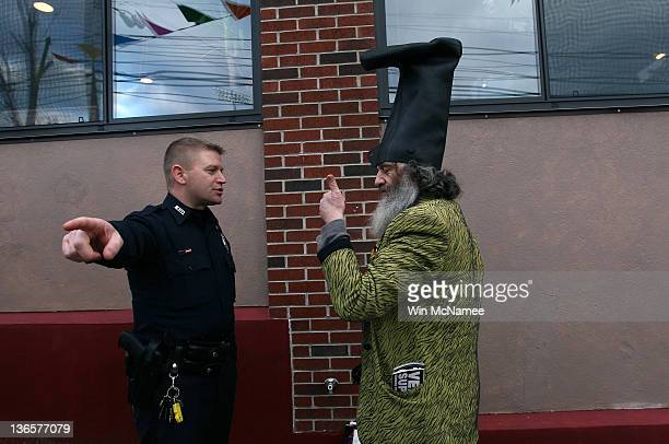 2d2ea3e0a12 While demonstrating fringe candidate Vermin Supreme is asked by a police  officer to move away from
