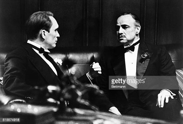 While his daughter's wedding celebration proceeds outside Don Corleone played by Marlon Brando discusses family business with his consigliori Tom...
