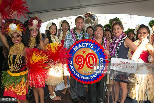 While holding a ceremonial drumhead Erick Dickens VP of Marketing King's Hawaiian center Mark Taira CEO King's Hawaiian and Amy Kule Executive...