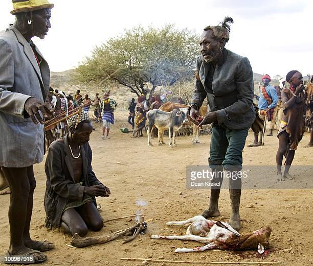 While it is purified by smoke the chief of the Hamar tribe villiage of Unga Bayno consults with other elders about what he has found in a slain kid...