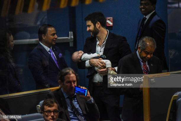 While Jacinda Ardern Prime Minister of New Zealand delivers a speech at the United Nations her partner Clarke Gayford holds their baby Neve during...
