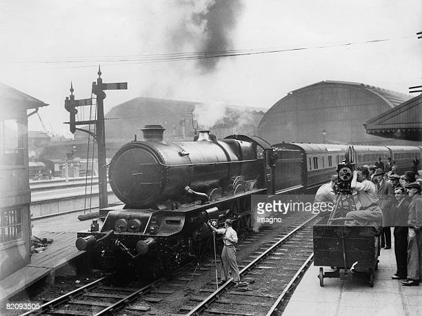 "While leaving Paddington Station, the noise of the train ""Cornish Riviera"" is recorded for the film ""The Rome Express,"" Photograph, London, 1932..."