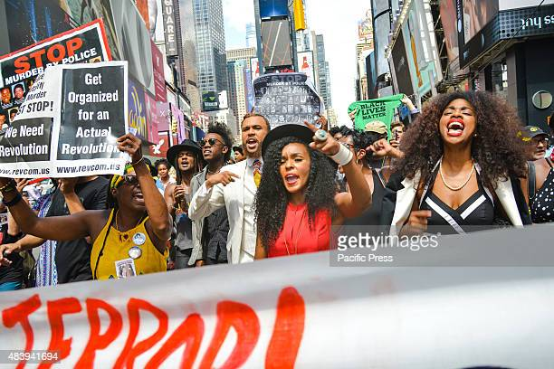 While marching on Broadway through Times Square protesters including musician Jidenna sing Wondaland's new protest anthem Hell You Talmbout Members...