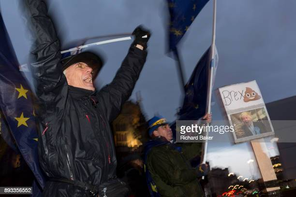 While MPs debate the Brexit Withdrawal Bill and ultimately vote in the House of Commons ProEU AntiBrexit protesters wave EU and Union Jack flags next...