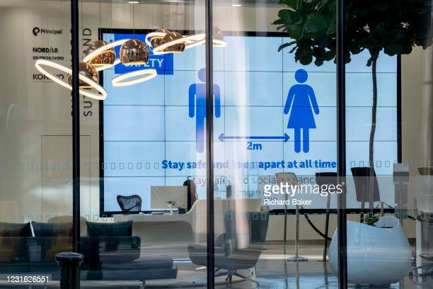 While office workers remain at home in accordance to government Covid guidelines and individual company policies, a solitary receptionist works alone...