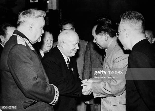 While on a trip to China Supreme Soviet President Nikita Khrushchev shakes hands with Mao Zedong president of the People's Republic of China Marshal...