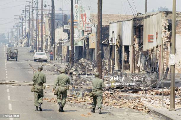 While on patrol a trio of National Guardsmen walk burnedout businesses on a street in the Watts neighborhood after the declaration of Marshall Law...