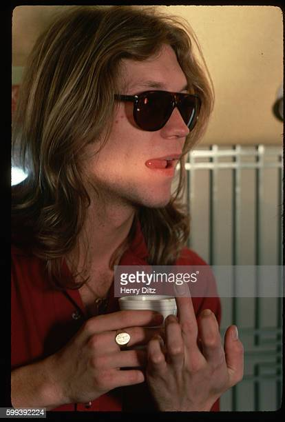 While on tour with the rock band America Gerry Beckley gestures with his finger
