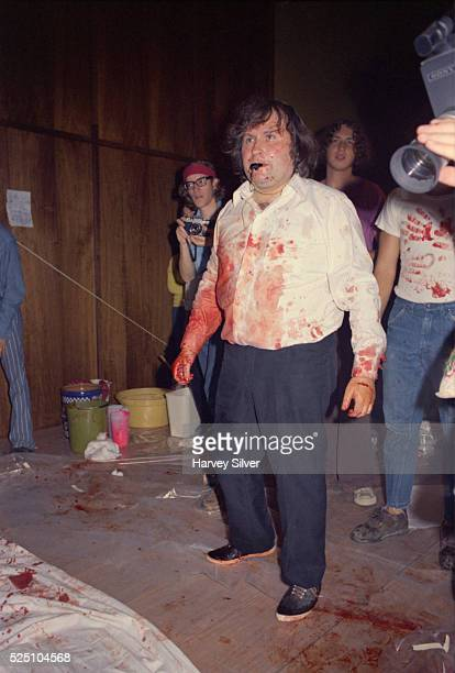 While performing at Harpur College Austrian artist Hermann Nitsch receives student assistance during a blood orgy which included a staged crucifixion...