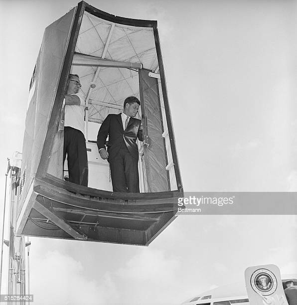While recovering from a back injury President John F Kennedy rides a lift operated by Roland Gates to board plane