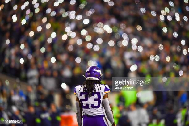 While Seattle Seahawks fans hold cell phones, Mike Boone of the Minnesota Vikings waits for the fourth quarter to start during the game at...