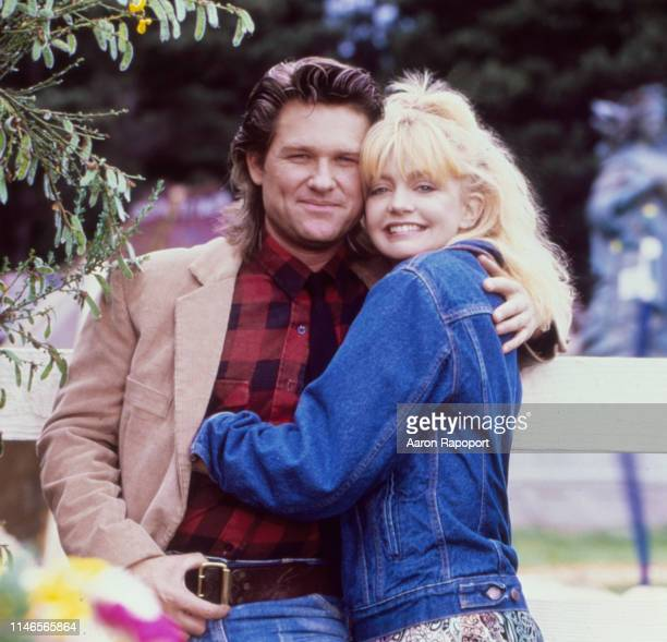 While shooting the movie Overboard actors Goldie Hawn and Kurt Russell pose for a portrait in October 1987 in Fort Bragg California