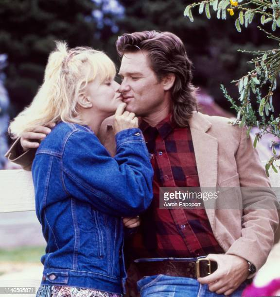 "While shooting the movie ""Overboard"", actors Goldie Hawn and Kurt Russell pose for a portrait in October 1987 in Fort Bragg, California."