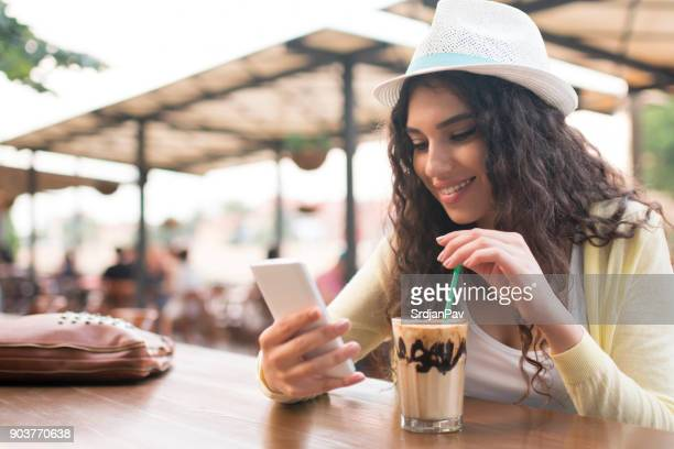 while sitting at a cafe... - iced coffee stock pictures, royalty-free photos & images