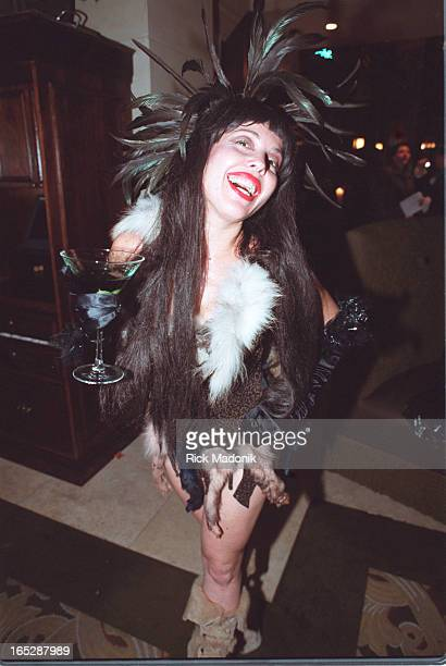 While son Evan Shane is entertained by a costumed partygoer Paul Stanley and wife Pamela Bowen enter the Courtyard Cafe for the final wrap party of...