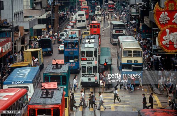 While still a British colony heavy 1990s traffic of cars trams and buses on 21st April 1995 in Central Hong Kong China