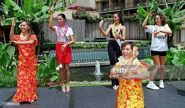 While taking a break from filming, Jewel Lobaton, Miss Philippines 1998 , Katharina Mainka, Miss Germany 1998 , and Juliana Renee Thiessen, Miss...