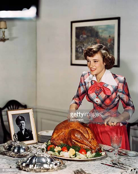 While the men are away during the holidays fighting in World War II Phyllis Thaxter still cooks a turkey If you notice there is a picture of a...