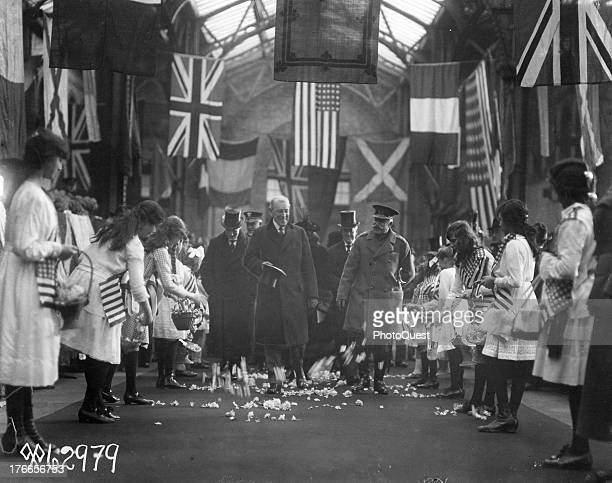 While the preliminaries for the opening of the Paris Peace Conference were being arranged, United States President Woodrow Wilson visited England...