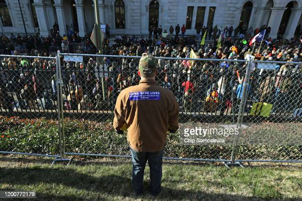 While thousands of gun rights advocates attend a rally organized by The Virginia Citizens Defense League inside a fenced in area on Capitol Square...