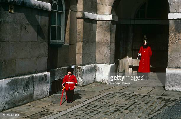 While visiting London's tourist sites a young boy of about 5 yearsold spends time at Horse Guards where a soldier from the Household Cavalry also...