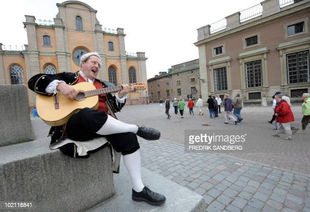 While waiting for tourists to guide Henrik Miko sings and plays his guitar dressed like the Swedish 18th century trubadour Carl Michael Bellman with...