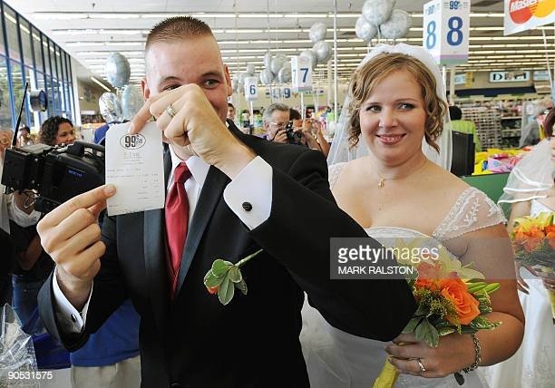 Whillis Hall and Emily Wiley show their receipt for their 99 cent wedding ceremony at a checkout at the 99 cent store in Los Angeles on September 9...