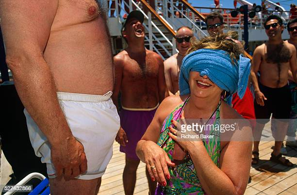 Whilst on a cruise aboard the Fun Ship Ecstasy during a voyage from Miami around the Gulf of Mexico passengers enjoy a sexual game on deck beneath a...