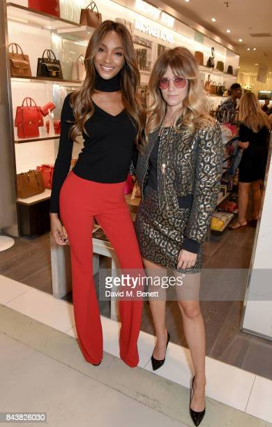 Whinnie Williams poses with Jourdan Dunn who hosted a Michael Kors event for the launch of the Peace and Love backpack in partnership with Grazia UK...