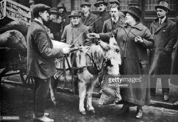 A 'whip woman' Covent Garden London 19261927 When all the transport of the market was supplied by horses it was necessary to have someone to mind the...
