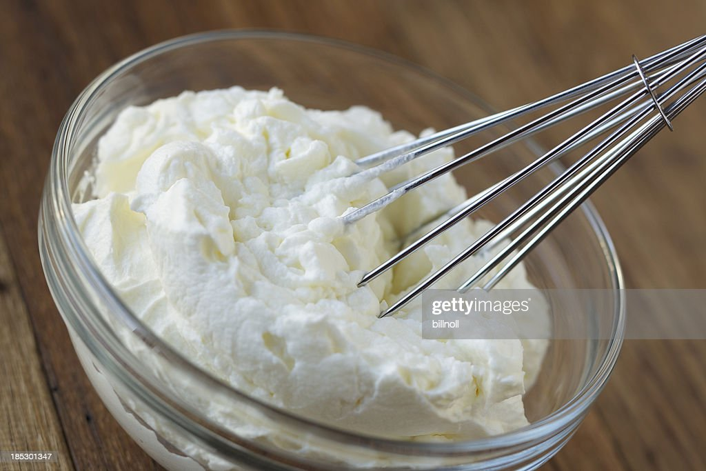 Whipped cream and whisk in glass bowl : Stock Photo