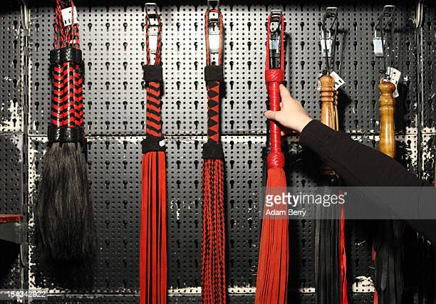 Whips for sadomasochistic fetishists hang for sale at the 2012 Venus Erotic Fair at Messe Berlin on October 18 2012 in Berlin Germany The trade fair...