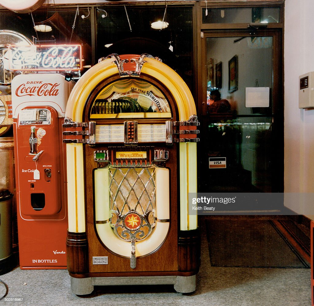 The hi-tech One More Time from Wurlitzer, left, plays 100 selections and is base on Model 1015 from 1946; about $7,000 at Juke Box Saturday Night and The Right Stuff.