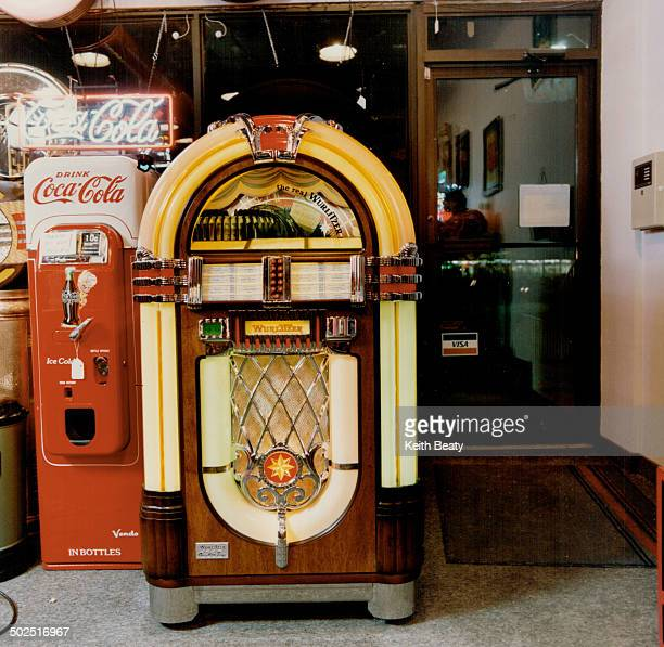 Whirl Away The hitech One More Time from Wurlitzer left plays 100 selections and is base on Model 1015 from 1946 about $7000 at Juke Box Saturday...