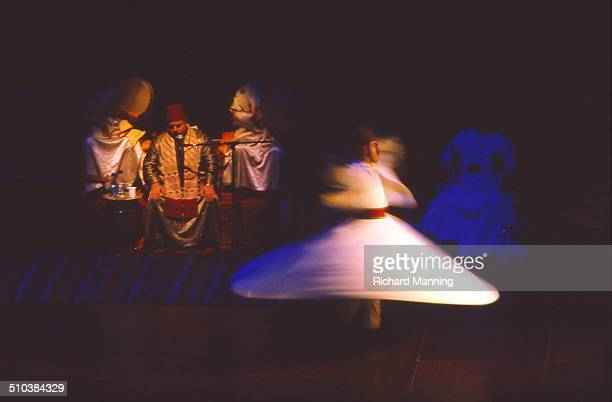A Whirling Dervish from the Al Kindi Ensemble Mevlevi Sufis from Damascus in Syria performing at the South Bank Centre in London After Eadweard...
