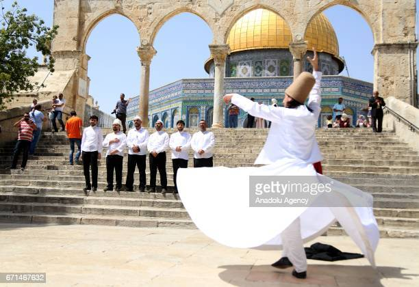 Whirling dervish performs the Sama during the Night of the Isra' and Mi'raaj celebrations in Jerusalem on April 22, 2017. People marched from...