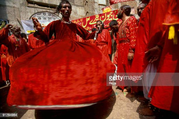 Whirling dervishes during the annual celebration of the Urs of Lal shahbaz Qalandar, a 13th century Sufi Master worshiped alike by Hindus and...