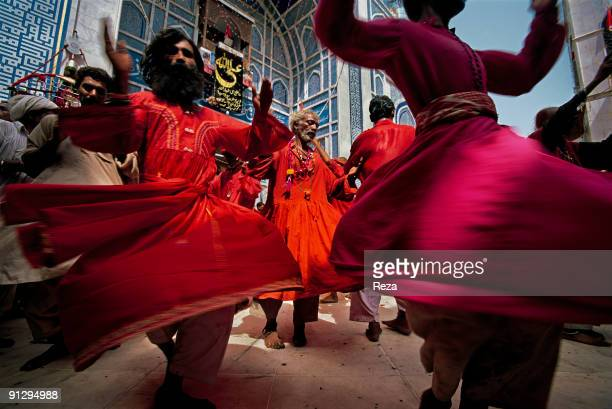 Whirling dervishes during the annual celebration of the Urs of Lal shahbaz Qalandar a 13th century Sufi Master worshiped alike by Hindus and Muslims...