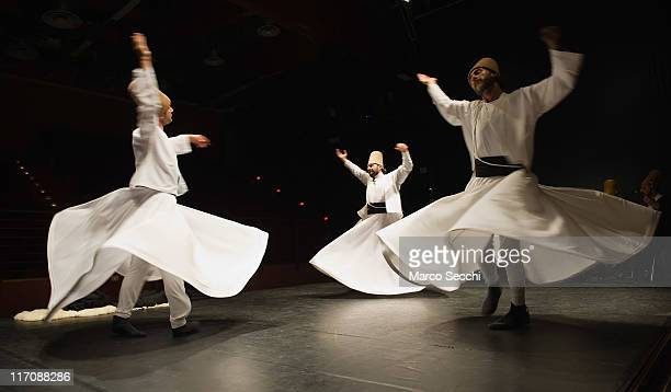 Whirling Dervishes of the Galata Mevlevi Ensemble perfom at Auditorium Candiani on June 21 2011 in Venice Italy The whirling dance associated with...